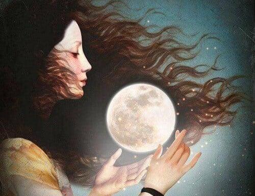 Nainen pitelee kuuta
