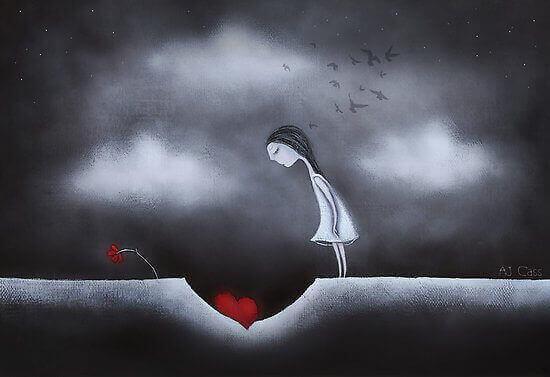tyttö katsoo sydäntä joka on kuopassa