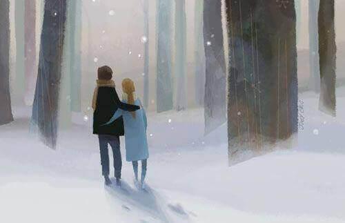 onnellinen pari lumessa