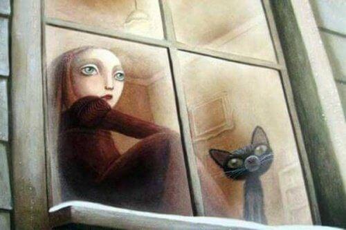 tyttö ja kissa istuvat ikkunalaudalla
