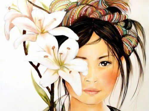 Tyttö kukkien takana