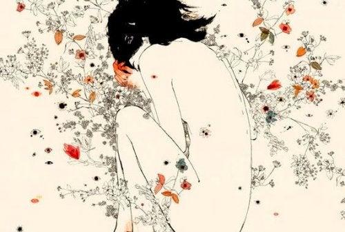Nainen kukkapenkissä